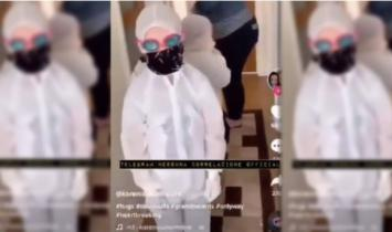 ONDE VAMOS PARAR? Vídeo bizarro mostra crianças vestidas com 'ternos COVID' para conhecer os avós